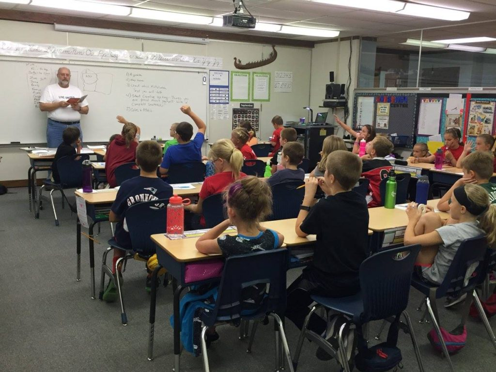 Craig engaging fourth grade students at Roland Story Elementary.